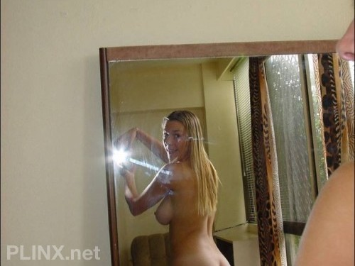 Busty Chick Self Shoots In The Mirror